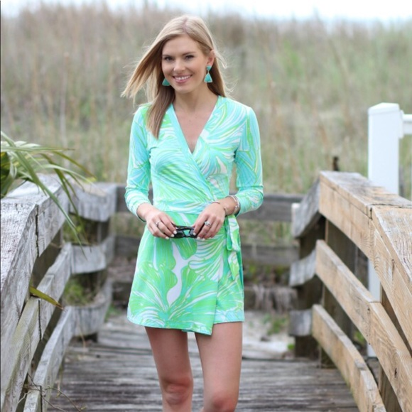 adc08034a11e Lilly Pulitzer Pants - Lilly Pulitzer Karlie Wrap Romper in Green Fronds